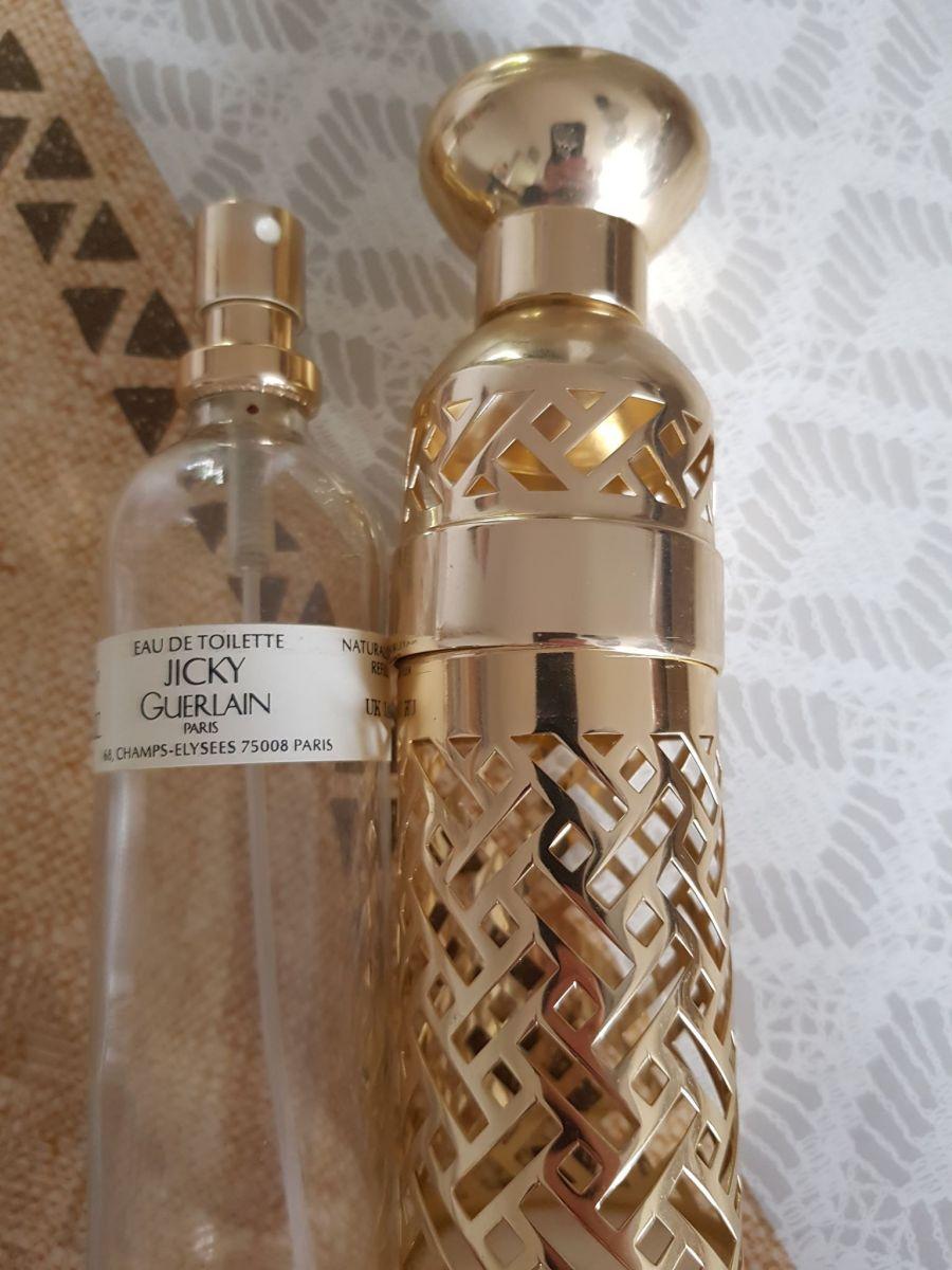Dahlia » - (années 1990) Flacon à parfum en cristal incolore pressé moulé dépoli.