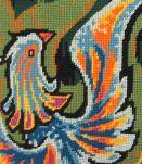 Canevas oiseau de feu  encadré avec soin. artisanal. cadre :