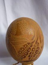 Gourde en noyau sculpté