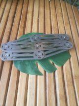 dessous de plat en métal accordéon