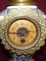 Parure d'horloge bronze et faïence