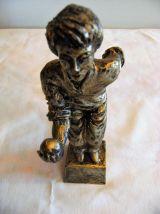 Statuette résine dorée joueur de boule pétanque