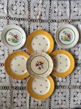 Sept assiettes dessert dépareillées ,fleuries jaunes vertes.