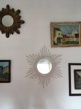 Miroir soleil vintage en rotin.