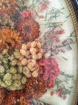 Grand cadre ovale bouquet de fleurs séchées au verre bombé.
