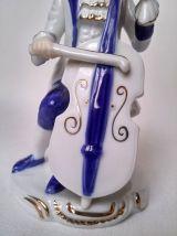 statuette figurine de porcelaine musicien