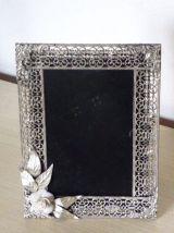 Cadre art deco en metal ciselé avec une rose art deco
