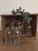 3 petites bouteilles de pharmacie graduées