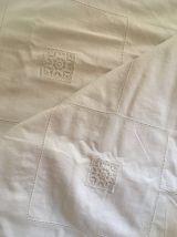 Housse duvet en coton blanc et volants.