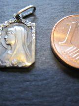 petite médaille avec raz du coup Petite médaille en argent