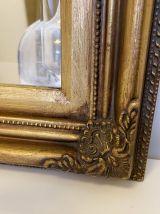 Miroir antique doré en bois