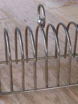 Ancien porte toasts en métal argenté 8 compartiments