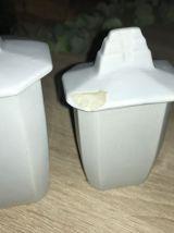 Quatre pots à épices anciens en faïence