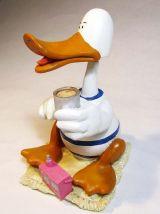 Figurine canard à la plage