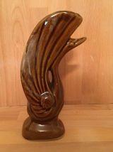 Charmant vase représentant un cygne en céramique marron.