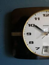 Horloge formica vintage pendule silencieuse Bayard noir doré