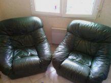 Paire de fauteuils en cuir