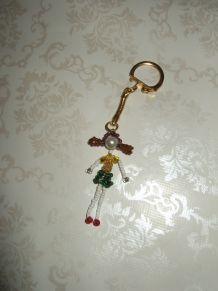 Porte-clé fillette perles de rocaille rouge,vert,jaune,blanc