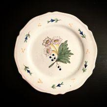 Assiette plate en faïence début XXème siècle