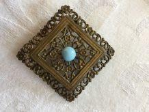 Broche vintage métal et perle bleue