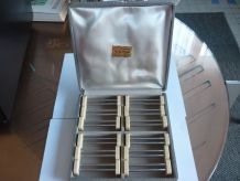 12 porte couteaux metal et bakelite beige