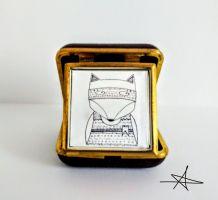Cadre original avec un réveil matin de voyage chocolat - Le Renard Masqué