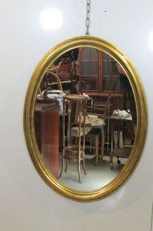 Grand miroir ovale en bois doré