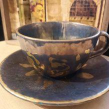 Tasse à thé et sa soucoupe en ceramique bleu et or