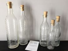 Série de 5 petites bouteilles graduées de pharmacie