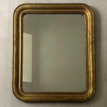 Miroir début XXème en bois et stuc doré