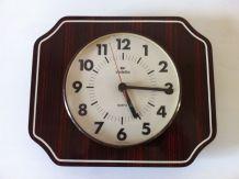 Horloge pendule murale vintage en formica Vedette