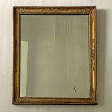 Miroir époque restauration en bois et stuc doré