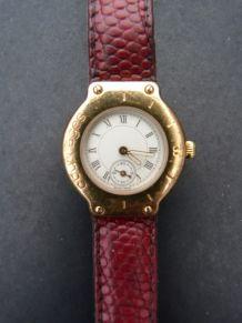 Courrège montre croco plaqué or