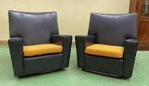 Paire de fauteuils club des années 70 en skaï
