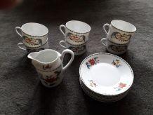 6 tasses et soucoupes et un pichet porcelaine de Paris
