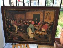 Cadre/Reproduction Repas de noces paysanes Pieter Bruegel