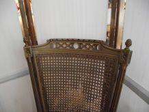 Fauteuil de bureau, dossier cannelé style Louis XVI.