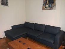 Canapé d'angle gauche 5 places en tissu bleu nuit