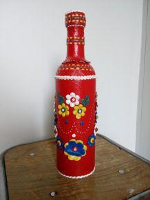 Grande bouteille, gourde, habillée de cuir très coloré, de l'ex-Yougoslavie
