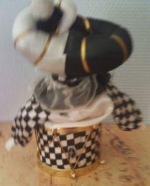 Poupée harlequin musicale qui bouge