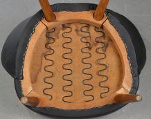 Fauteuil en cuir noir et laine