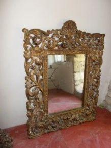 Miroir sculpté doré ancien