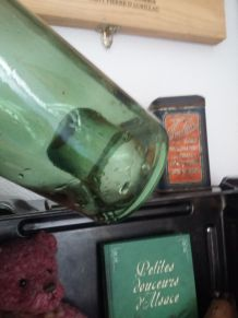Bouteille ancienne en verre soufflé
