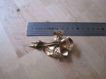 Broche ancienne en métal doré  art déco