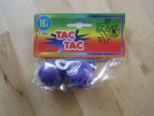 jouet tac tac dans pochette neuve couleur violet