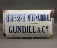 Rare plaque émaillée ancienne Réglisserie internationale Gun