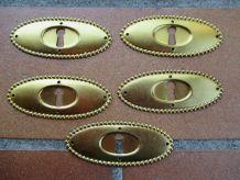 Entree de serrure ancienne ovale dorée pour meuble