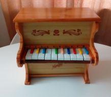 Petit piano en bois vintage