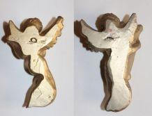 Deux statuettes murales dorées anges musiciens