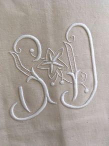 Drap en coton métis monogrammé S D .